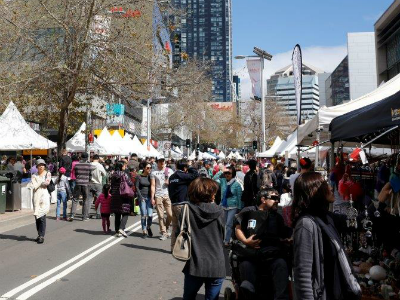 People attending an open air market in Chatswood