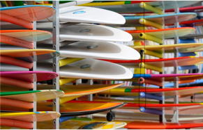 A colourful rack of surfboards