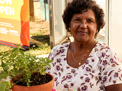 A woman holding a pot plant