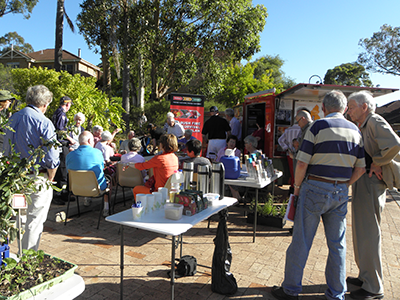 An outdoor community meeting discussing bush fire survival