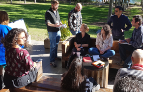 A group of people at an outdoor community briefing session