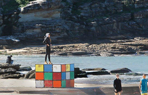 Greater Sydney Planning Awards woman standing on Rubik's cube statue